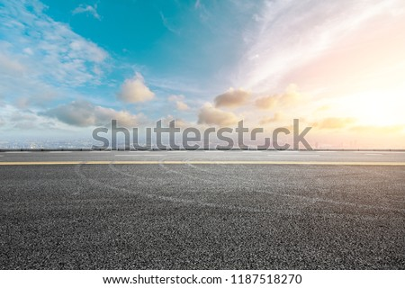Panoramic skyline and buildings with empty road #1187518270