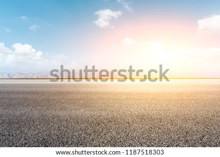 Panoramic skyline and buildings with empty road #1187518303