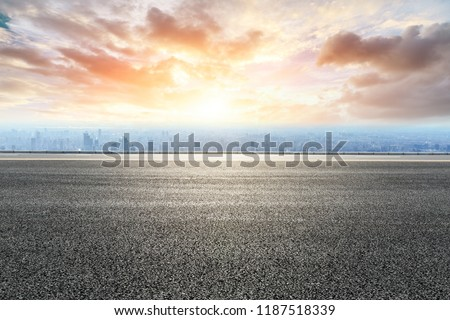 Panoramic skyline and buildings with empty road #1187518339