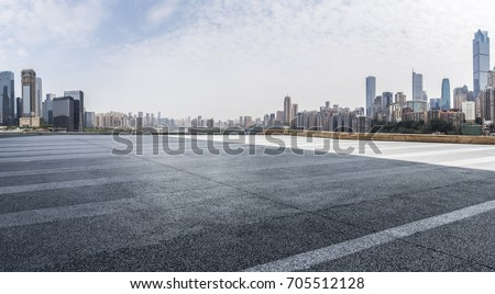 Panoramic skyline and buildings with empty road #705512128