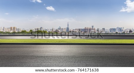 Panoramic skyline and buildings with empty road  #764171638