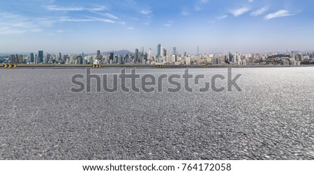 Panoramic skyline and buildings with empty road  #764172058