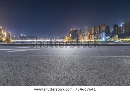 Panoramic skyline and buildings with empty road?chongqing city at night