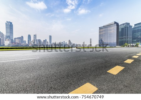 Panoramic skyline and buildings with empty road?chongqing city?china