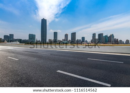 Panoramic skyline and buildings with empty road,shanghai city,china