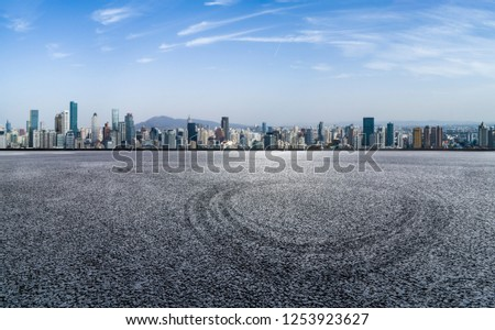 Panoramic skyline and modern business office buildings with empty road,empty concrete square floor #1253923627