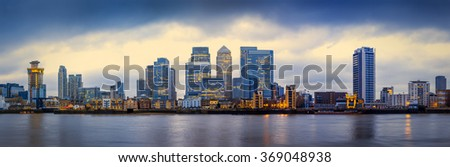 Panoramic skyline of Canary Wharf, the worlds leading financial district at blue hour - London, UK #369048938