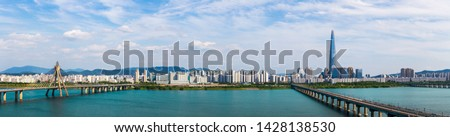 Panoramic Skyline of Subway and Han gang River. Aerial view cityscape of Seoul, South Korea. Aerial Viewpoint  Lotte tower. Beautiful clouds