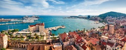 Panoramic summer cityscape of old medieval city - Split, Croatia, Europe. Sunny morning seascape of Adriatic sea. Beautiful world of Mediterranean countries. Traveling concept background.