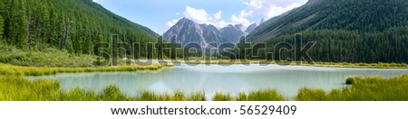 Panoramic summer view of mountains and lake in Altay, Russia
