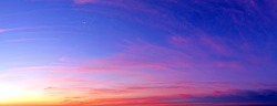 Panoramic sunrise starry sky and crescent landscape background. Panorama of dawn sky with red cloudscape. Natural color of sunset. Ultra wide wallpaper