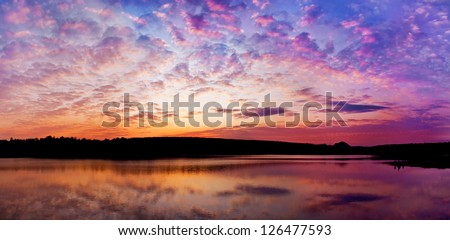 panoramic sunset above the lake with bright colors go very well for site header