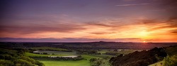 Panoramic sunset over England with rolling landscape