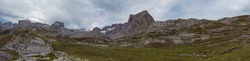 Panoramic upper start section of hiking track PR-PNP 24 to the magnificient summits of Mounts Pena Remona, Torre de Salinas, La Padierna and Pico de San Carlos at Picos de Europa National Park, Spain.