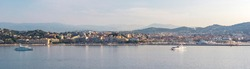 Panoramic view, aerial skyline of city Cannes, Mediterranean Sea with yachts, coastline, port morning at dawn in Cannes, Cote d'Azur, France