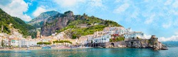 Panoramic view, aerial skyline of small haven of Amalfi village with tiny beach and colorful houses, located on rock, Amalfi coast, Salerno, Campania, Italy