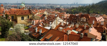 Panoramic view at red Prague roofs