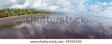 Panoramic view at the beach of Matapalo, Costa Rica. Matapalo is located in the Southern Pacific Coast. The main attractions are surfing and eco-tourism., Matapalo
