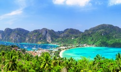 Panoramic view at viewpoint of beautiful tropical Phi Phi island in Krabi province, Thailand. Famous Koh Phi-Phi Don island with white sand beach and turquoise water under blue sky.