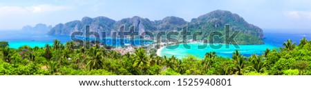 Panoramic view at viewpoint of beautiful tropical Phi Phi island in Krabi province, Thailand. Famous Koh Phi Phi Don island with white sand beach and turquoise water under blue sky