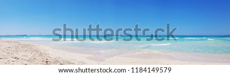 Panoramic view background beach with sea wave. Texture sand. Blue sky and azure coast. Gentle pastel colors. Relax atmosphere. Es trenc, Mallorca, Spain