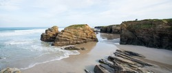 Panoramic view beautiful beach with rocks and no people