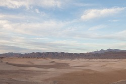 panoramic view death valley with some mountains on the back