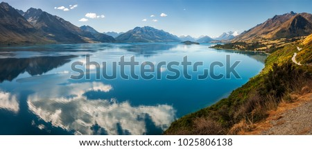 Panoramic view from Bennett's Bluff Lookout on one of the most scenic drives in New Zealand that connects Queenstown and Glenorchy and overlooks Pig and Pigeon Islands and Lake Wakatipu. - Shutterstock ID 1025806138