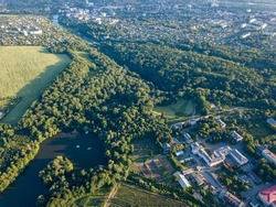 Panoramic view from drone to National Dendrological Park Sofiyivka and the area of city Uman, Ukraine in the summer day. Aerial view from the drone.