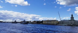 Panoramic view from the bridge of the warships Frigate and Corvette in the waters of the Neva River on the Day of the Navy in St. Petersburg.