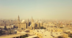 Panoramic view from the top of the Citadel of Saladin, overlooking Old Cairo, the Mosque of Sultan Hassan and Al-Rifa'i Mosque, Cairo, Egypt