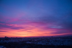 Panoramic view from the window. Dawn in the city