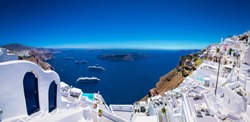 Panoramic view from Thira on cruise ships in Santorini island, Greece.