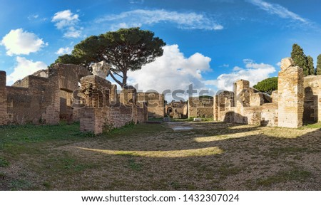 Panoramic view in the Archaeological excavations of Roman village of Ostia Antica,  with with ruins of ancient buildings with Roman arches and carved capitals - Rome, Italy #1432307024