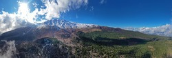 Panoramic view in virtual reality at 180 degrees of the Etna volcano surrounded by woods, lava flows and secondary craters in autumn. Sicily Italy.