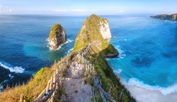 Panoramic view Karang Dawa, Manta Bay or Kelingking Beach on Nusa Penida Island, Bali Indonesia. Tropical beach with a turquoise ocean among the rocky cliffs Sunset on a tropical island Travel concept