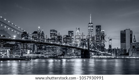panoramic view new york city downtown manhattan skyline at night with skyscrapers and brooklyn bridge #1057930991