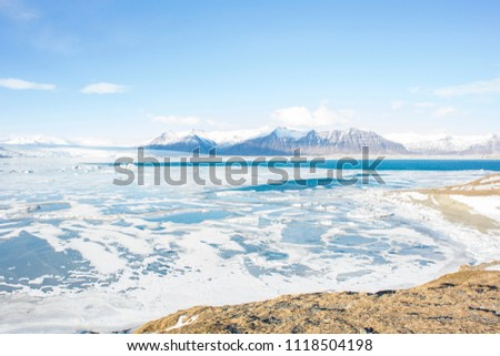 Panoramic view of a beautiful cold winter landscape with icebergs in Jökulsárlón glacial lagoon, Vatnajökull National Park, southeast of Iceland, Europe. #1118504198