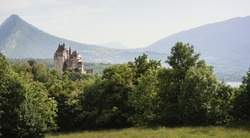 Panoramic view of a castle in the mountains - surroundings of Annecy, France