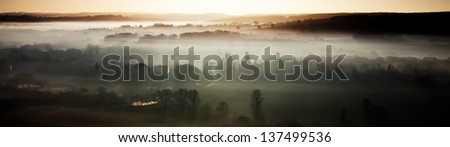 Panoramic view of a misty rural morning in England