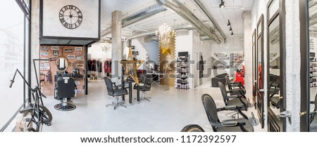 Panoramic view of a modern bright beauty salon. Hair salon and make up store, barber shop and manicure interior business  #1172392597
