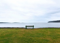 Panoramic view of a quiet bench facing the Atlantic ocean