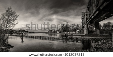 panoramic view of a river with a train trestle crossing over it