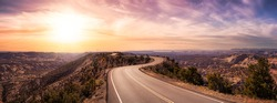 Panoramic View of a scenic route on top of a mountain ridge in the desert. Colorul Sunset Sky Art Render. Taken on Route 12, Utah, United States of America.