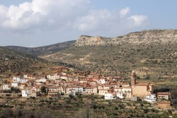 Panoramic view of a small picturesque village in the province of teruel in aragon, spain. The village belongs to the region of Maestrazgo and it is called Seno