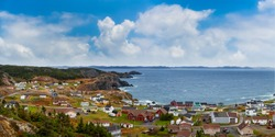 Panoramic view of a small town on the Atlantic Ocean Coast. Colorful Blue Sky Art Render. Taken in Crow Head, North Twillingate Island, Newfoundland and Labrador, Canada.