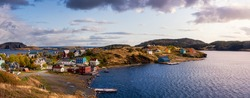 Panoramic view of a small town on the Atlantic Ocean Coast. Dramatic Colorful Sunrise Sky Art Render. Taken in Trinity, Newfoundland and Labrador, Canada.