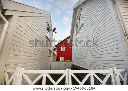 Panoramic view of a small village in fjords, modern traditional houses with tiled roof, falu red dye. Rogaland, Norway. Architecture, travel destinations, tourism, sailing, cruise Stock fotó ©