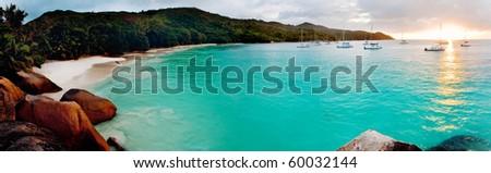 Panoramic view of a tropical beach at dawn. Anse Lazio, Praslin island, Seychelles, Indian Ocean.