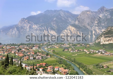 panoramic view of a village on the shores of Lake Garda surrounded by mountains
